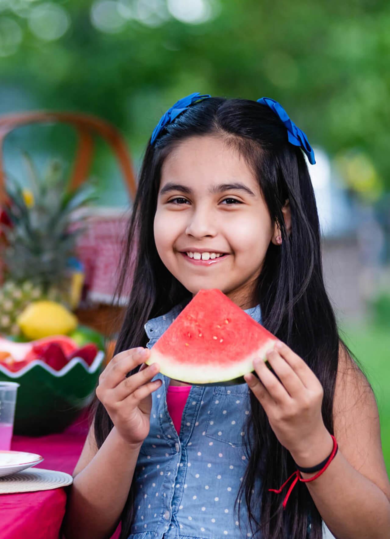 About Girl enjoying Kids Choice Watermelon slice